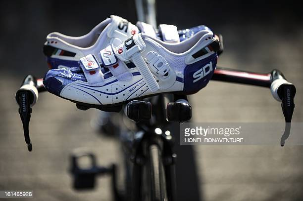 The pair of shoes belonging to a Kazakh's cycling team rider is seen on a bicycle on July 2 2010 in Capelle aan den Ijssel outside Rotterdam at the...