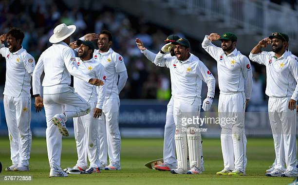 The Pakistan team celebrate after winning the match by 75 runs during day four of the 1st Investec Test match between England and Pakistan at Lord's...
