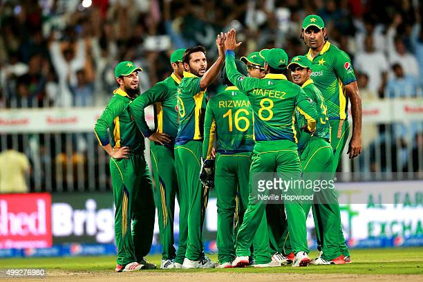 The Pakistan team celebrate the wicket of Joe Root of England during the 3rd International T20 match between Pakistan and England at Sharjah Cricket...