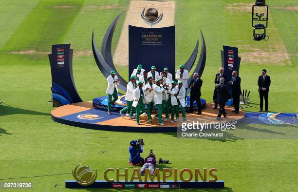 The Pakistan team lift the trophy as they celebrates winning the final during the ICC Champions Trophy Final match between India and Pakistan at The...