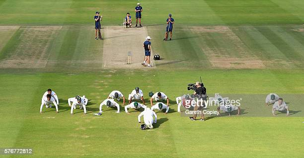 The Pakistan team perform push ups in celebration after winning the 1st Investec Test between England and Pakistan at Lord's Cricket Ground on July...