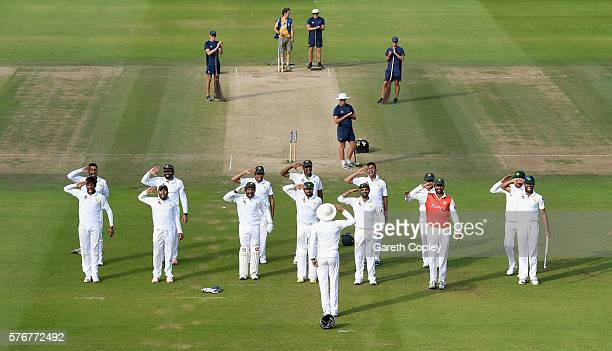 The Pakistan team salute Younis Khan of Pakistan in celebration after winning the 1st Investec Test between England and Pakistan at Lord's Cricket...