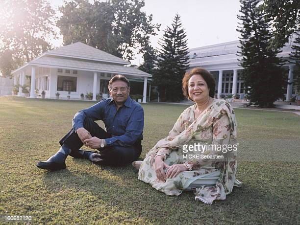 The Pakistani President Pervez Musharraf and his wife Sehba clothed the shalwar kameez sitting on the lawn of yellow garden of their residence...