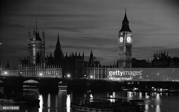The Palace of Westminster at night London 19451980 General view of the Houses of Parliament from the River Thames with St Stephen's Tower which...