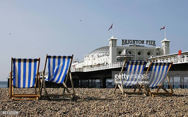 The Palace Pier on Brighton seafront is seen before the crowds arrive as the Birtish summer finally sees some sunshine in Brighton on July 24 2004 in...