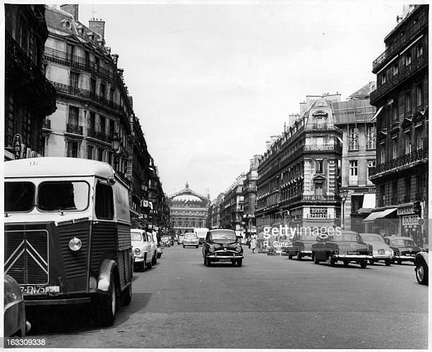 The Palais Garnier an ornate opera house scene at the end of the street in Paris France 1955