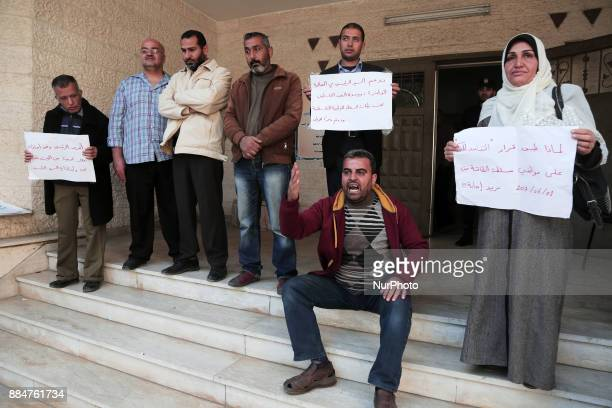 The Palestinian Authority employees in the Gaza Strip take part in a protest demanding their right after Palestinian Authority force them into early...