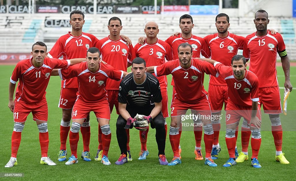 The Palestinian football team pose for photos prior to their knockout game of the Peace Cup invitational tournament in Manila on September 3 2014...