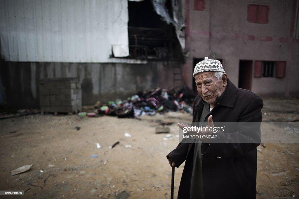 The Palestinian owner of a damaged plastic factory, gestures in front of a pile of melted plastic in Beit Hanun, in the northern Gaza Strip, on November 11, 2012, following Israeli artillery fire and shelling. Five Gazans were killed and 30 injured by Israeli shelling after militants fired an anti-tank rocket at an Israeli jeep, wounding four soldiers, sources on both sides said.