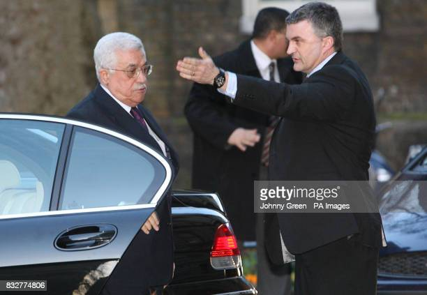 The Palestinian President Mahmoud Abbas left arrives at No 10 Downing Street in central London