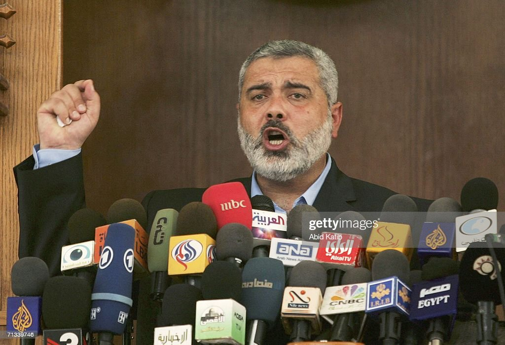 The Palestinian Prime Minister and Hamas leader <a gi-track='captionPersonalityLinkClicked' href=/galleries/search?phrase=Ismail+Haniyeh&family=editorial&specificpeople=543410 ng-click='$event.stopPropagation()'>Ismail Haniyeh</a>, gives the weekly Friday prayer speech in Al Mohatah mosque on June 30, 2006 in Gaza City, Gaza Strip. Haniyeh demanded that Israel cease its offensive in Gaza and that Palestinian leaders were working to end the crisis over the kidnapped Israeli soldier.