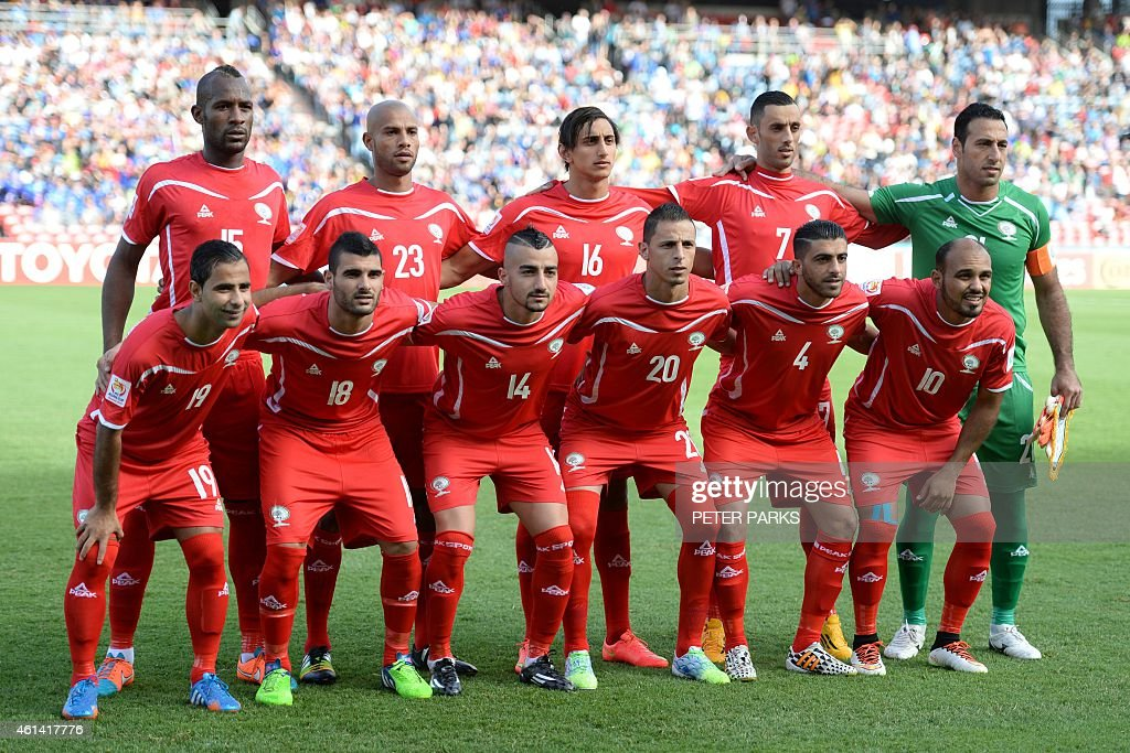 The Palestinian team pose for a photo before their game against Japan during their Group D football match of the AFC Asian Cup in Newcastle on...