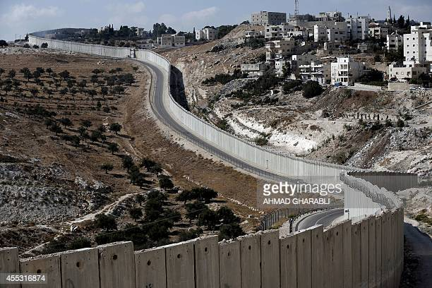 The Palestinian West bank city of Abu Dis is seen near the Israeli separation barrier on September 12 2014 Fortythree Israeli reservists and former...