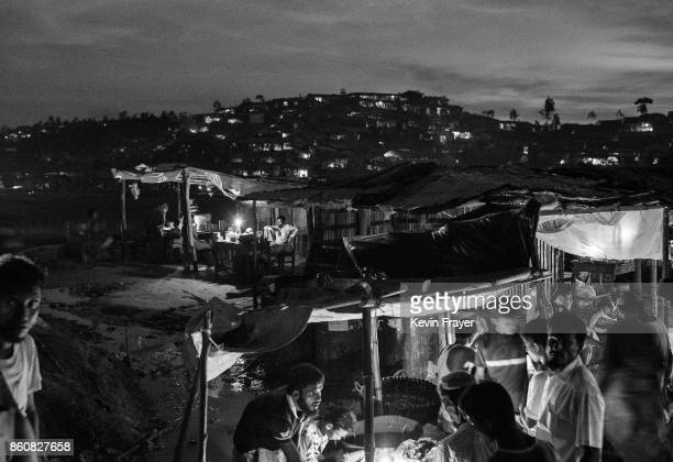 COX'S BAZAR BANGLADESH SEPTEMBER 24 The Palingkali Rohingya refugee camp is seen at night on September 24 2017 in Cox's Bazar Bangladesh More than...