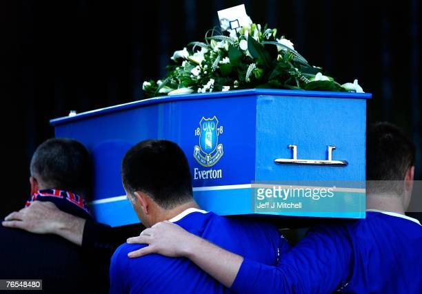The pallbearers carry the coffin of Rhys Jones with his father Steve and brother Owen both wearing Everton shirts at Liverpool Cathedral for the...