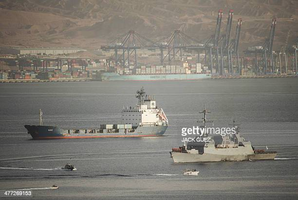 The Panamanianflagged KlosC is escorted into the southern Israeli port of Eilat by Israeli warships on March 8 2014 after it was intercepted by the...