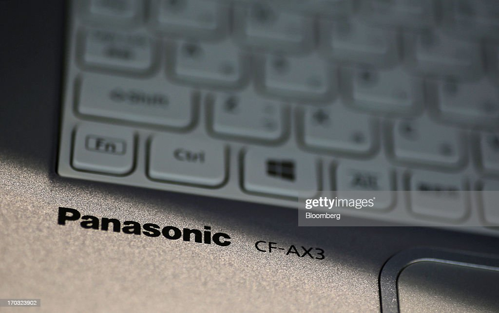 The Panasonic Corp. logo is displayed on the company's Let's Note CF-AX3 laptop computer at the Panasonic plant in Kobe City, Hyogo Prefecture, Japan, on Tuesday, June 11, 2013. Panasonic manufactures electric and electronic products. Photographer: Yuriko Nakao/Bloomberg via Getty Images