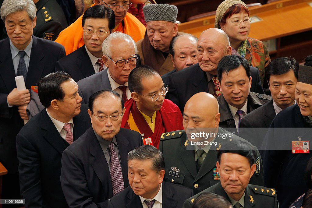The Panchen Lama (C), the second highest Tibetan Buddhist leader, leaves after the opening session of the 11th National Committee of the Chinese People's Political Consultative Conference (CPPCC) at the Great Hall of the People on March 3, 2012 in Beijing, China. The Chinese People's Political Consultative Conference opens on March 3 in Beijing.