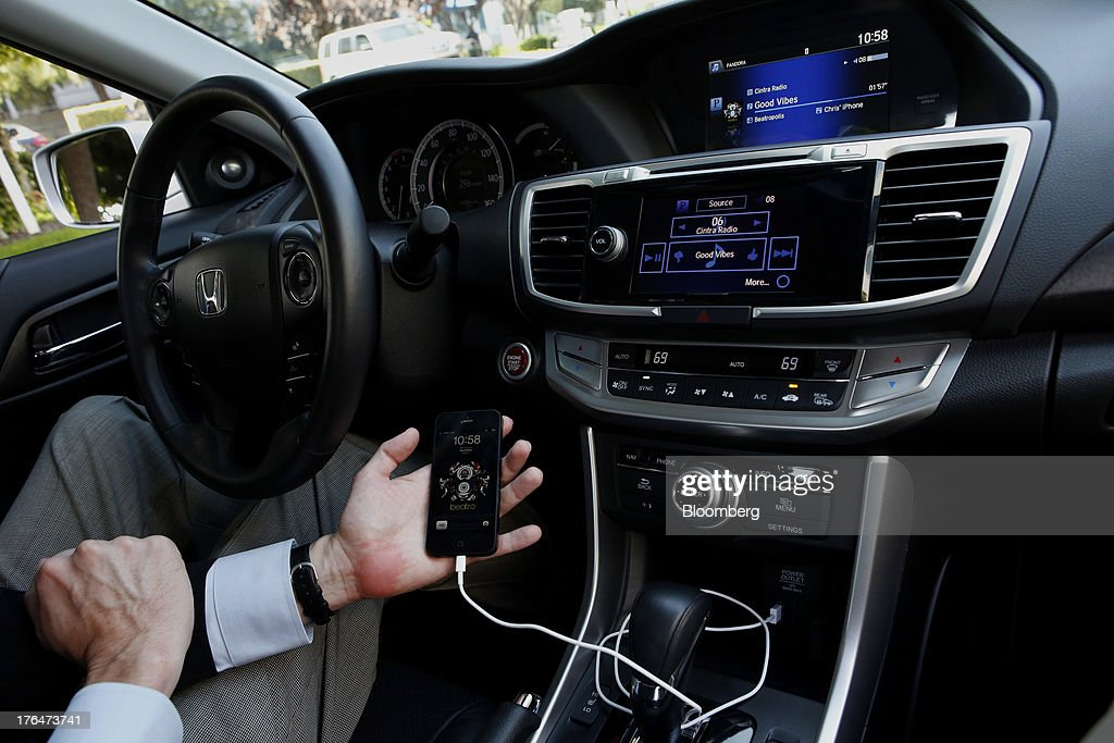 The Pandora Media Inc. integrated entertainment system is demonstrated with an Apple Inc. iPhone 5 inside a Honda Accord vehicle at American Honda Motor Co. Inc. headquarters in Torrance, California, U.S., on Tuesday, Aug. 13, 2013. Honda Motor Co. has sold 218,000 Accords, and 191,000 Civics in the first 7 months of 2013, all standard with the integrated Pandora system. Photographer: Patrick Fallon/Bloomberg via Getty Images