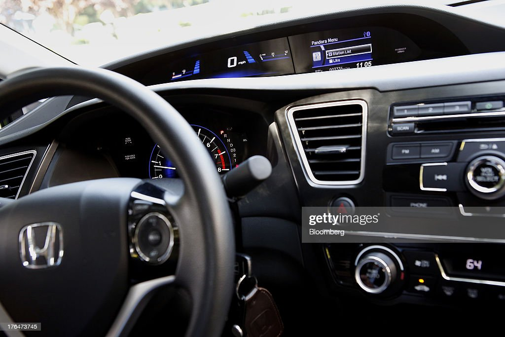 The Pandora Media Inc. integrated entertainment system is demonstrated with an Apple Inc. iPhone 5 inside a Honda Civic vehicle at American Honda Motor Co. Inc. headquarters in Torrance, California, U.S., on Tuesday, Aug. 13, 2013. Honda Motor Co. has sold 218,000 Accords, and 191,000 Civics in the first 7 months of 2013, all standard with the integrated Pandora system. Photographer: Patrick Fallon/Bloomberg via Getty Images