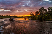 Barge at sunset on the Pangalanes canal, eastern Madagascar