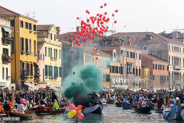 The 'Pantegana' releases ballons and smoke on Canaregio Canal at the end of the traditional regatta which officially opens the Carnival on the...
