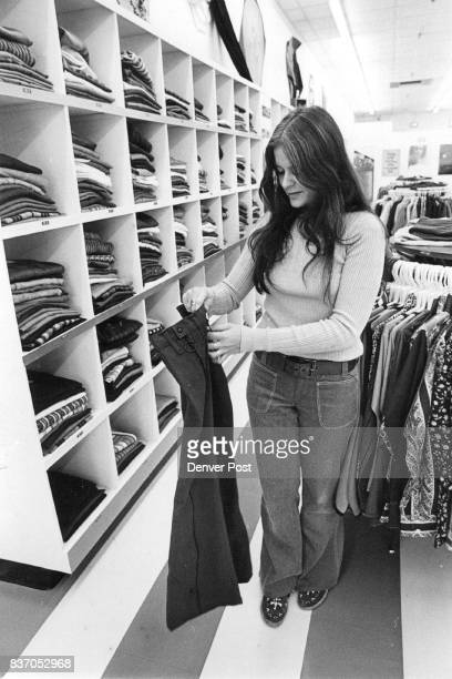 The pants she is holding unzip all the way down the front of both legs Store is in University Hills Plaza Credit Denver Post