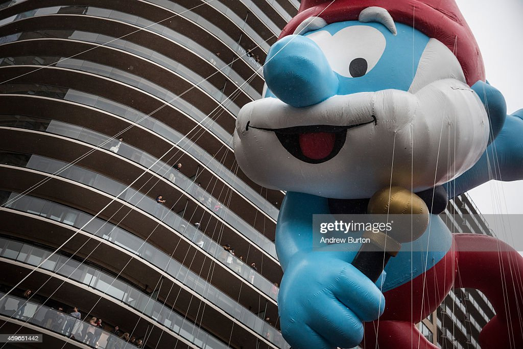 The Papa Smurf balloon floats south during Macy's Thanksgiving Day Parade on November 27 2014 in New York City Over 8000 people took part in the...