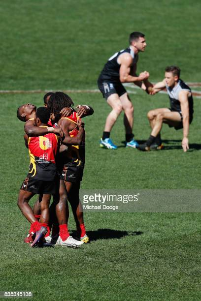 The Papua New Guinea celebrate after winning during the 2017 AFL International Cup Grand FInal match between New Zealand and Papua New Guinea at...