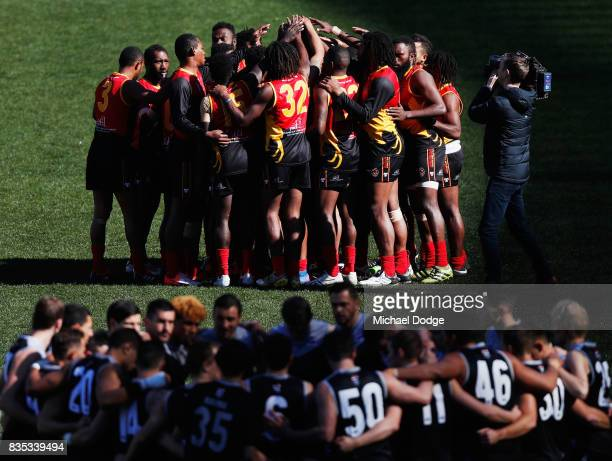 The Papua New Guinea team form a huddle during the 2017 AFL International Cup Grand FInal match between New Zealand and Papua New Guinea at Melbourne...