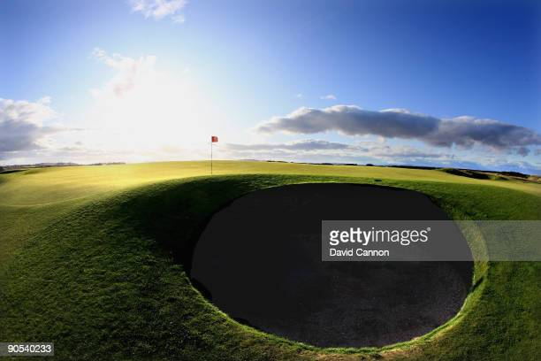 The par 3 11th green protected by the severe bunker at the front of the green on the Old Course at St Andrews on August 29 2009 in St Andrews Scotland