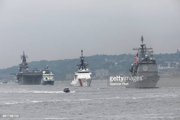 The Parade of Ships moves past the Statue of Liberty on the opening day of Fleet Week on May 24 2017 in New York City Now in its 29th year Fleet Week...