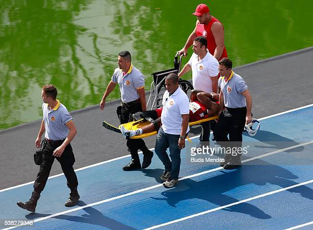 The paralympic athlete Richard Browne of the United States is carried on a stretcher after he suffered an injury during the 'Mano a Mano' challenge...