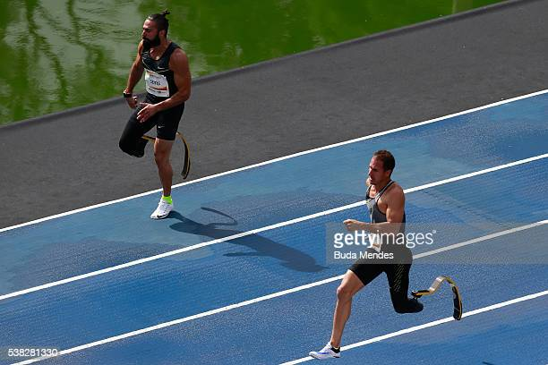 The paralympic athletes Arnu Fourie of South Africa and Michail Seitis of Greece run during the 'Mano a Mano' challenge at the Quinta da Boa Vista on...