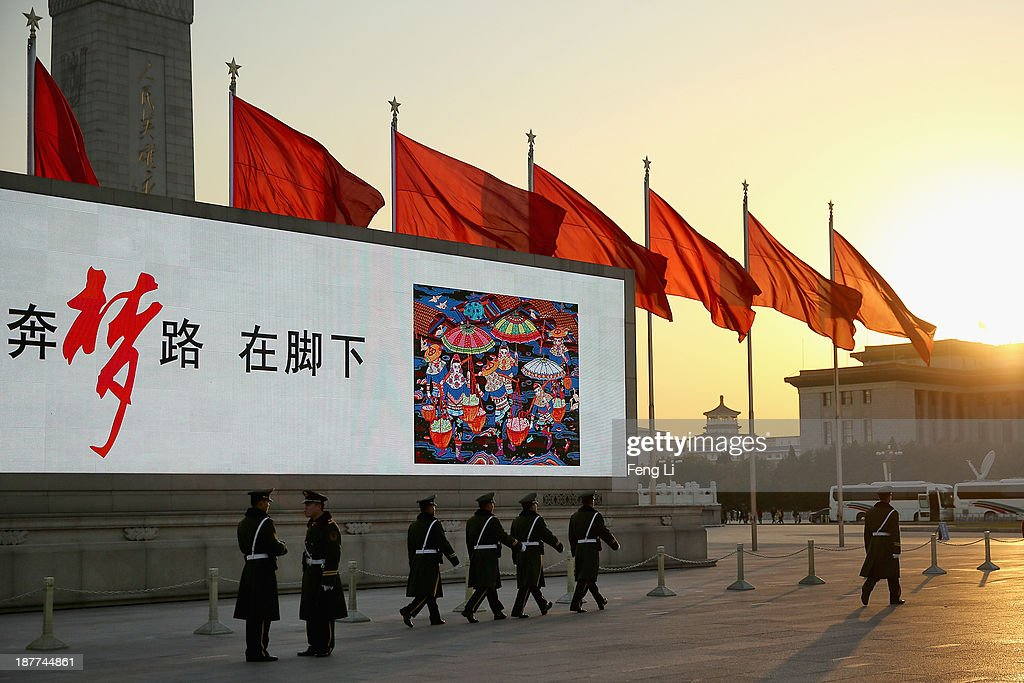 The paramilitary policemen patrol outside the Great Hall of the People where the Communist Party's 205-member Central Committee gathered for its third annual plenum on November 12, 2013 in Beijing, China. The 18th Central Committee of the Communist Party of China (CPC) approved a decision on 'major issues concerning comprehensively deepening reforms' at the close of the Third Plenary Session of the 18th CPC Central Committee on Tuesday.