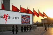The paramilitary policemen patrol outside the Great Hall of the People where the Communist Party's 205member Central Committee gathered for its third...