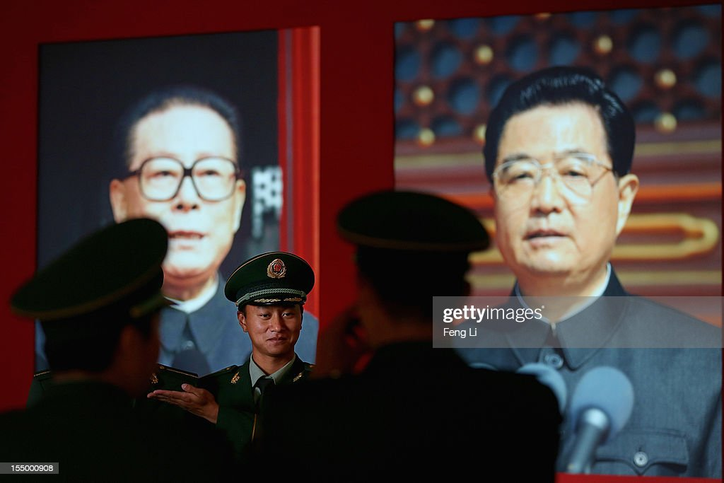 The paramilitary policemen pose in front of the portraits of China's President Hu Jintao and former President Jiang Zeming as visiting an exhibition entitled 'Scientific Development and Splendid Achievements' before the18th National Congress of the Communist Party of China (CPC) on October 30, 2012 in Beijing, China. The exhibition showcases China's progress in political, economic, cultural and ecological spheres over the past decade. The18th National Congress of the Communist Party of China (CPC) is proposed to convene on November 8 in Beijing.