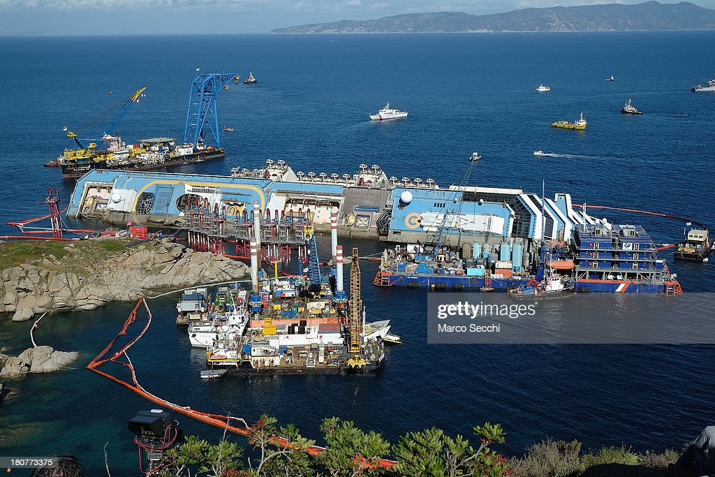 The parbuckling project to raise the stricken Costa Concordia continues on September 16 2013 in Isola del Giglio Italy Work begins today to right the...