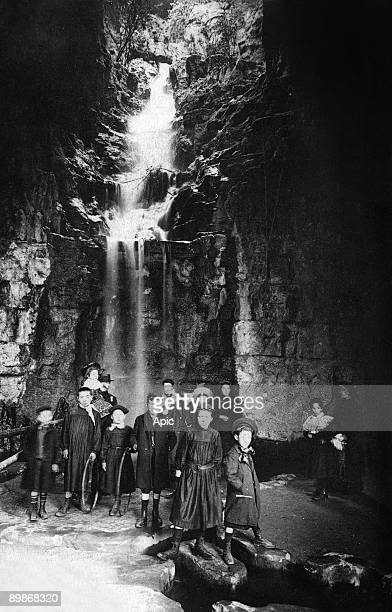 The Parc des Buttes Chaumont in Paris children in grotto of the waterfall postcard c 1907