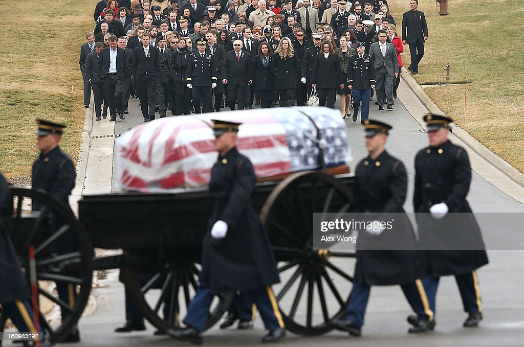 The parents of Army Sergeant Aaron X. Wittman, Bertha and Duane Wittman walk with other mourners during his funeral February 8, 2013 at Arlington National Cemetery in Arlington, Virginia. Sergeant Wittman, 28, of Chester, Virginia, was assigned to 3rd Battalion, 69th Armor Regiment, 1st Brigade Combat Team, 3rd Infantry Division in Fort Stewart, Georgia. He died on January 10, 2013 in Khogyani District of Nangarhar Province in Afghanistan, from injuries sustained after his unit was hit by a small arms fire.