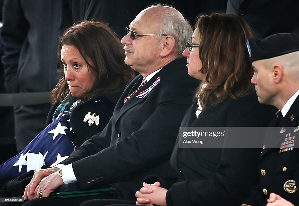 The parents of Army Sergeant Aaron X. Wittman, Bertha (L) and Duane Wittman (2nd L) attend the Sergeant Wittman's funeral February 8, 2013 at Arlington National Cemetery in Arlington, Virginia. Sergeant Wittman, 28, of Chester, Virginia, was assigned to 3rd Battalion, 69th Armor Regiment, 1st Brigade Combat Team, 3rd Infantry Division in Fort Stewart, Georgia. He died on January 10, 2013 in Khogyani District of Nangarhar Province in Afghanistan, from injuries sustained after his unit was hit by a small arms fire.
