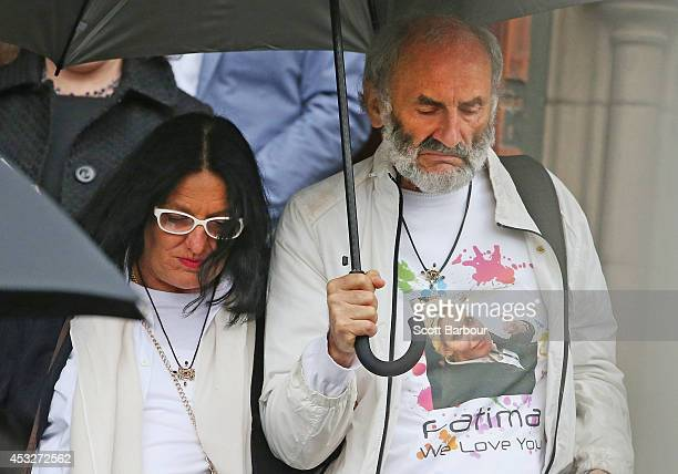 The parents of Australian MH17 victim Fatima Dyczynski Dr Jezy Dyczynski and Angela RudhartDyczynski leave after attending a national memorial...