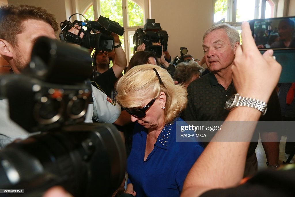 The parents of defendant Kevin Dahlgren (not in picture) who is charged with quadruple murder arrive at the courtroom for his trial on May 31, 2016 in Brno, Czech Republic. The US-citizen is accused of killing four of his relatives in the Czech Republic and then trying to incinerate their bodies. Kevin Dahlgren was extradited to the Czech Republic in 2015 after fleeing to the United States following the killings of his cousin, her husband and the couple's two sons. / AFP / Radek Mica