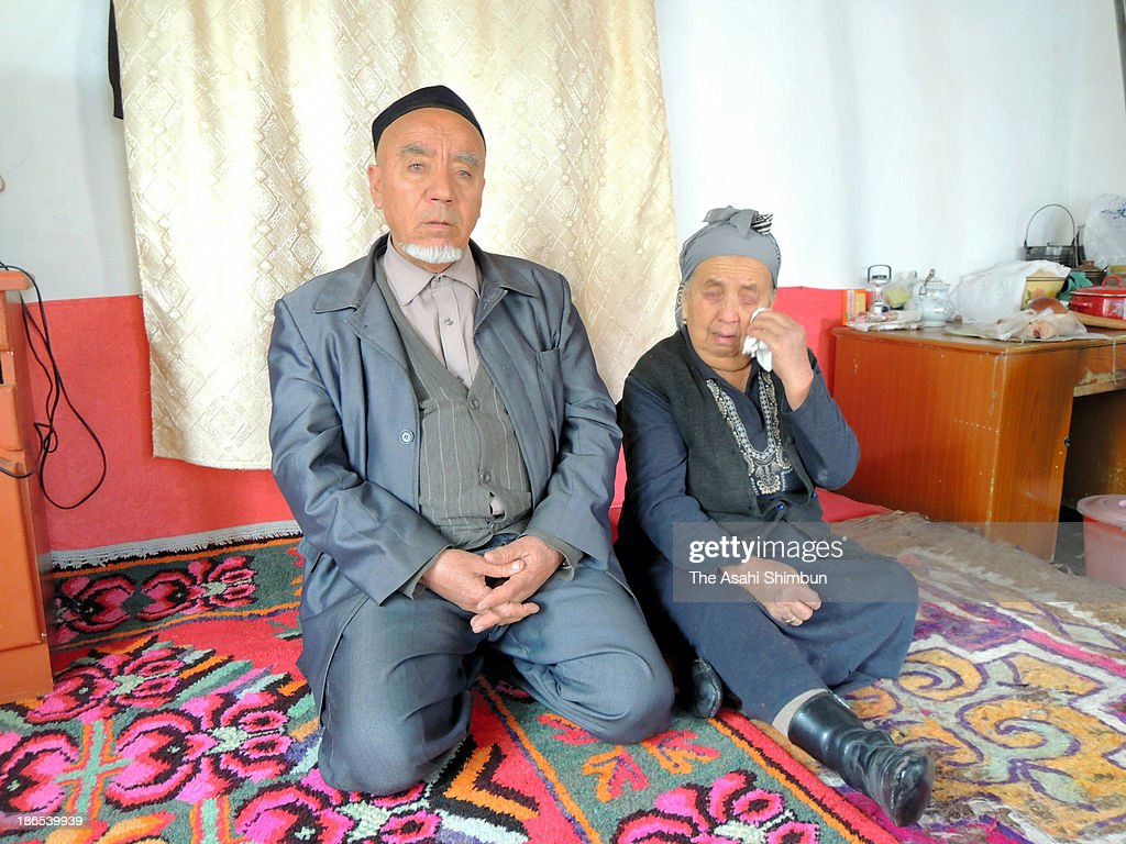 The parents of Husanjan Wuxur, 36, one of five suspects detained by Chinese authorities over the deadly vehicle crash at Tiananmen Square, speak during the Asahi Shimbun Interview on October 31, 2013 in Yining, in the western part of the Xinjiang Uighur Autonomous Region, China. The parents, denied their son had any association with Islamic fundamentalists, insist their son's innocense.