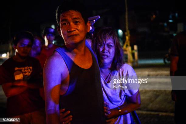 The parents of Irish Glorioso weep after learning their son was shot dead by unknown assailants in Navotas north of Manila Philippines June 8 2017...