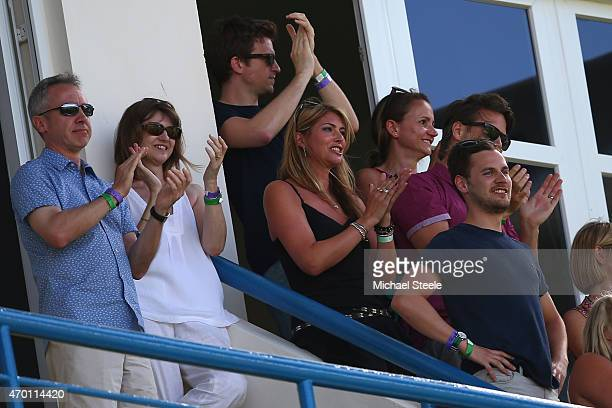 The parents of James Anderson and wife Daniella Anderson applaud after James Anderson of England claims the wicket of West Indies to pass Ian...