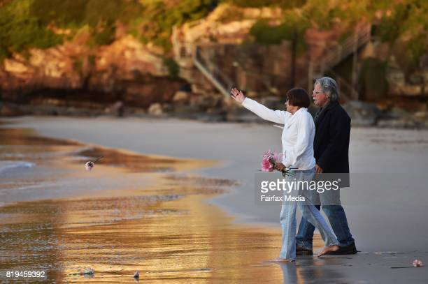The parents of Justine Damond John Ruszczyk and Maryan Heffernan are seen throwing a flower into the water during a vigil for their daughter at...