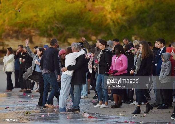 The parents of Justine Damond John Ruszczyk and Maryan Heffernan are seen embracing at the water's edge during a vigil for their daughter at...
