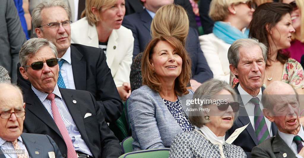 The Parents of Kate Middleton, Michael and Carole Middleton and the Farther of Tim Henman, Anthony Henman are in conversation as they watch on from the stands in centre court as Julien Benneteau of France is in action during the Men's Singles second round match against Kei Nishikori of Japan on day four of the Wimbledon Lawn Tennis Championships at the All England Lawn Tennis and Croquet Club on June 30, 2016 in London, England.