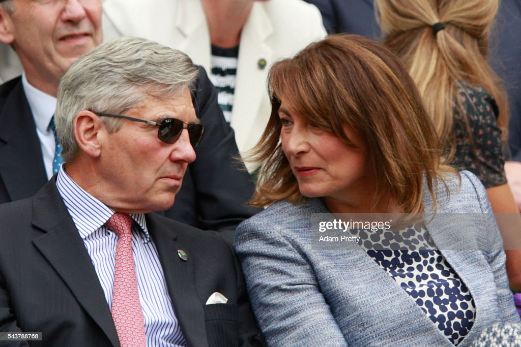 The Parents of Kate Middleton, Michael and Carole Middleton are in conversation as they watch on from the stands in centre court as Julien Benneteau of France is in action during the Men's Singles second round match against Kei Nishikori of Japan on day four of the Wimbledon Lawn Tennis Championships at the All England Lawn Tennis and Croquet Club on June 30, 2016 in London, England.